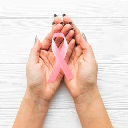 hands-with-pink-ribbon-over-timber-background_23-2147738486(1)